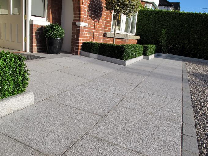 Bush hammered silver grey granite provides a stunning, durable and non slip surface finish